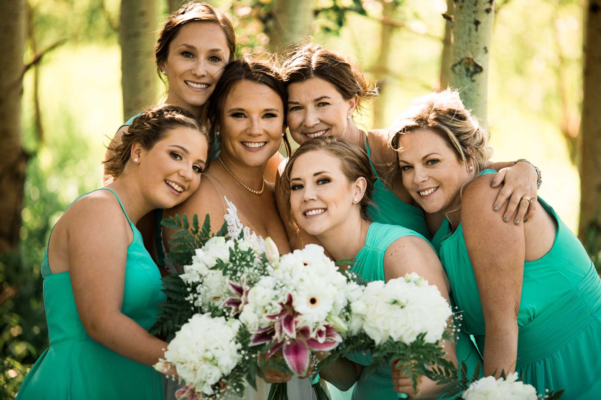 Calgary engagement and wedding photographer, bride and bridesmaids photo during bridal portraits at Nose Hill Park