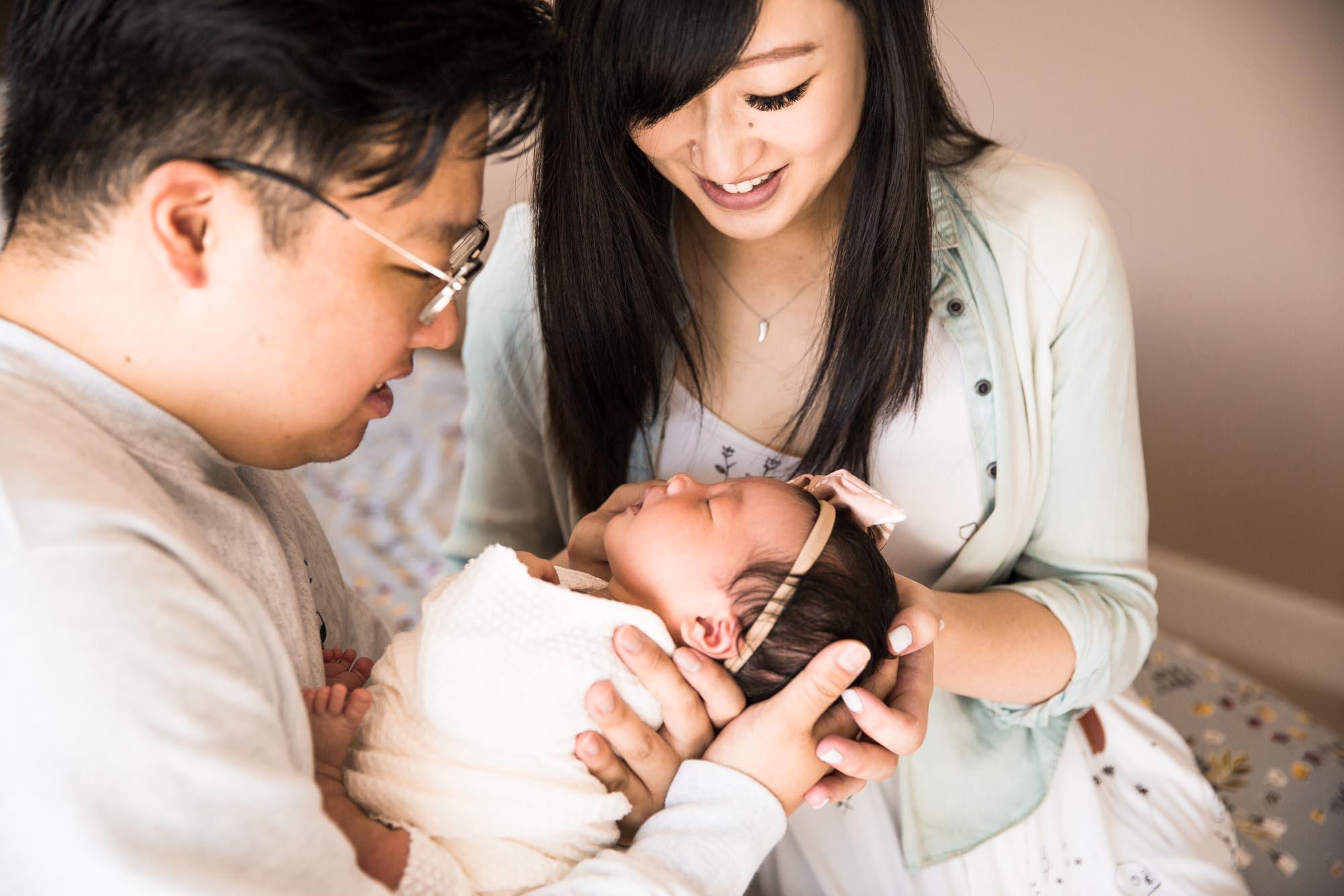 Calgary lifestyle newborn photographer - newborn baby with family