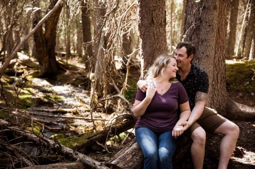 Calgary wedding photographer, engagement photos in a beautiful mountain location, couple in front of a creek