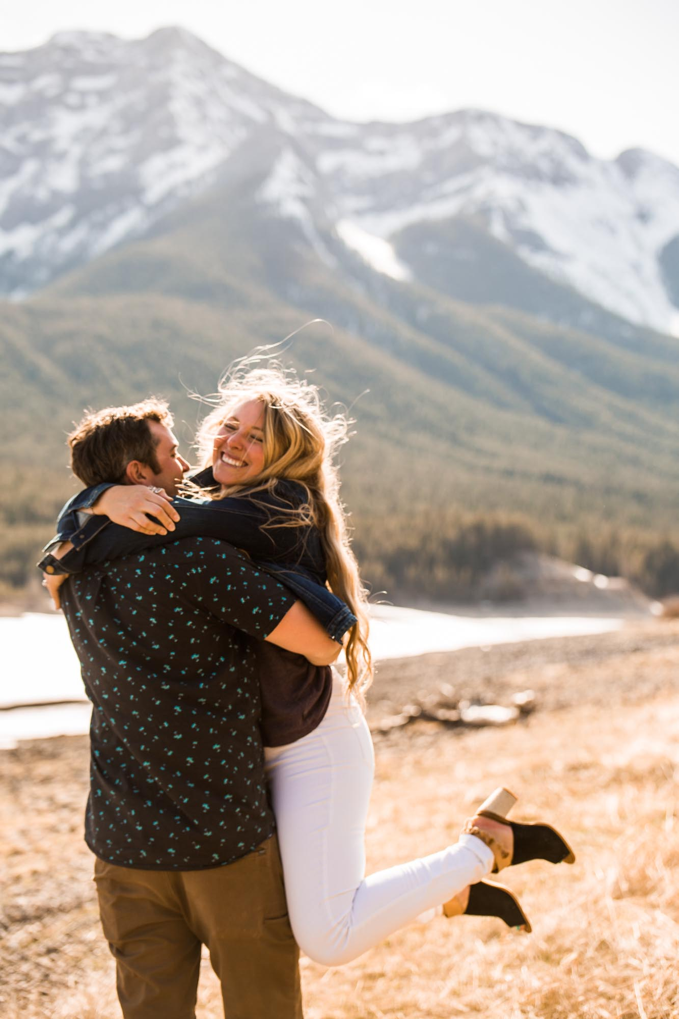 Calgary wedding photographer, engagement photos in a beautiful mountain location, couple in front of a mountain