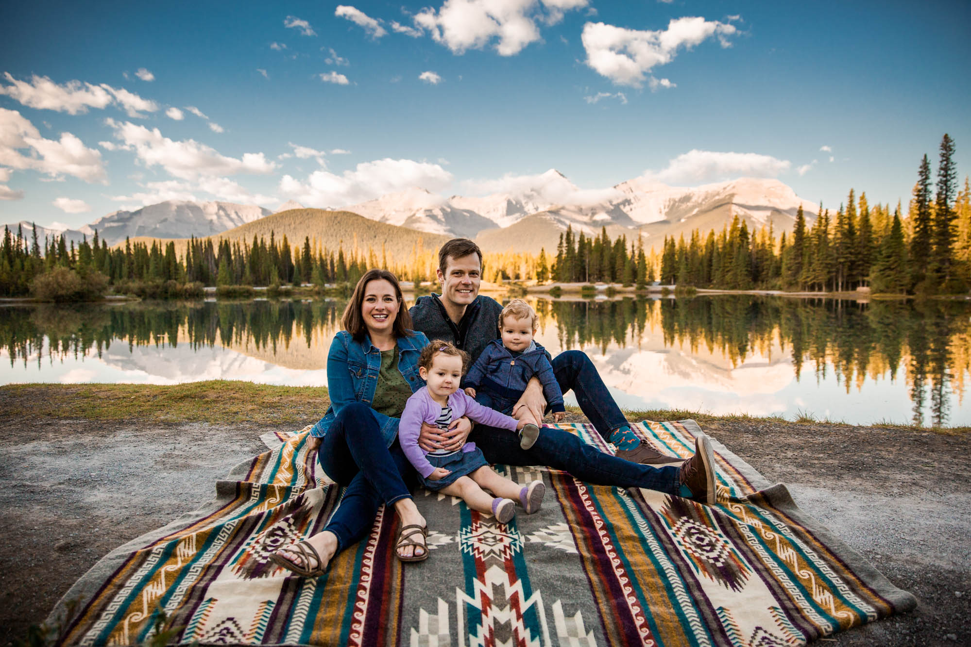 Calgary photographer, mountain locations for portrait photography, a family in front of water and mountains