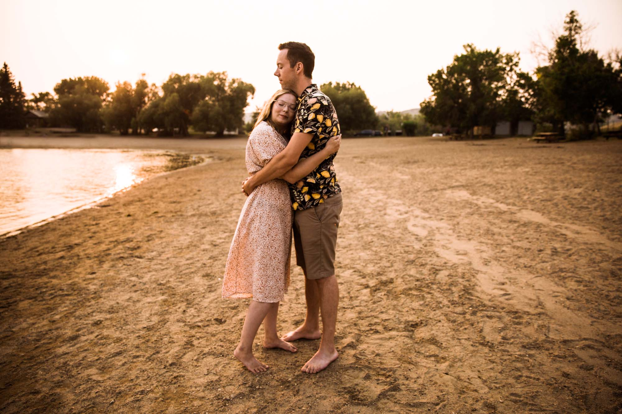Calgary wedding photographer, engagement session on the beach, couple at sunset at Little Bow Provincial Park