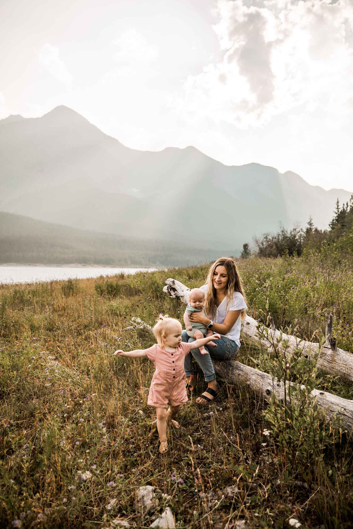 Calgary lifestyle family photographer, family photos by the water and mountains at sunset in Kananaskis Country