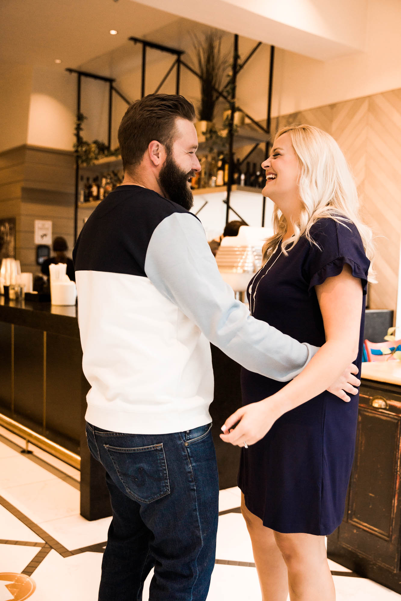 Calgary wedding photographer, engagement photos at Alforno Bakery and Cafe, couple sitting getting coffee