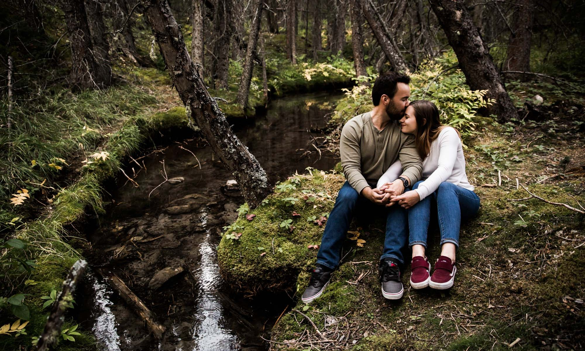 Calgary wedding and engagement photographer, couple in the mountains for adventure engement photos in Kananaskis Country